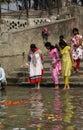 Hindu people bathing in the ghat near the Dakshineswar Kali Temple in Kolkata Royalty Free Stock Photo