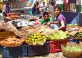 Hindu people in indian market men selling vegetables Stock Images