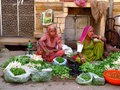 Hindu people in indian market women dressed the bright colorful clothes Stock Image