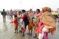 Hindu pilgrims doing rituals on the sea beach of gangasagar around kms south of kolkata on january sadhus and from Stock Photos
