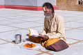 Hindu priest gangotri uttarakhand circa may a sits in the temple courtyard to read vedic scriptures in gangotri circa may Stock Images