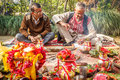 Hindu priests with worshiping stuffs flowers and other on the yard of house in chitwan nepal Stock Images