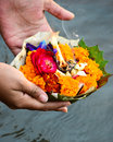 Hindu rituals religion offering flowers to ganga river Stock Photo