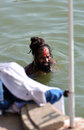 Hindu Sadhu Bathing in Ganges Stock Photo
