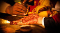 Hindu wedding ritual in india hina mehndi on grooms hand during a marriage Stock Images