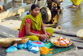 Hindu women in indian street market dressed colorful orange red green yellow and blue sari trading and selling flowers Royalty Free Stock Photo