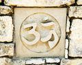 Hinduism s om symbol ceramic tile in old rock wall with the sign a religious representing tile is one of a series of seven Royalty Free Stock Photos