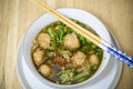 Hinese clear soup with boiled meatball and mixed vegetables Royalty Free Stock Photo