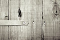 Hinge close up of a on a wooden door in monochrome Stock Photos