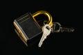 Hinged lock with keys on black background Stock Photo