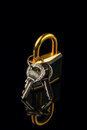 Hinged lock with keys on black background Royalty Free Stock Images
