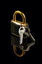 Hinged lock with keys on black background Royalty Free Stock Image