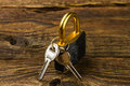 Hinged lock with keys on wooden background Royalty Free Stock Images