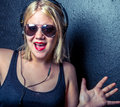 Hip girl listening to music and dancing happily Royalty Free Stock Image