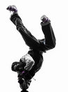 Hip hop acrobatic break dancer breakdancing young man handstand one silhouette white background Stock Photos