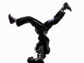 Hip hop acrobatic break dancer breakdancing young man handstand one silhouette white background Royalty Free Stock Photos