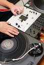 Hip-hop DJ scratching the vinyl record Stock Images