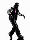 Hip hop moonwalking break dancer breakdancing young man silhouet Royalty Free Stock Photo