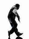 hip hop moonwalking break dancer breakdancing young man silhouette Royalty Free Stock Photo