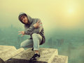 Hip hop performer posing, cityscape on background Royalty Free Stock Photo