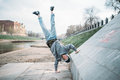 Hip hop performer, upside down motion on street Royalty Free Stock Photo