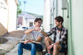 Hip men sitting on steps in the city Royalty Free Stock Photo