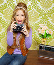 Hip retro little girl shooting on vintage camera Royalty Free Stock Photo