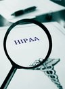 Hipaa document with magnifying glass Stock Photography
