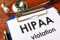 HIPAA violation form on a clipboard. Royalty Free Stock Photo