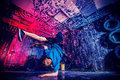 Hiphop man trendy young dancer dancing in the old garage Royalty Free Stock Images