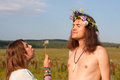 Hippie blow seed dandelion young couple outdoors Royalty Free Stock Photography