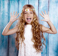 Hippie children girl excited open mouth with raised hands and arms Stock Photo