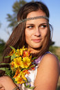 Hippie girl with lily outdoors Stock Photo
