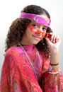 Hippie girl tipping glasses Stock Image
