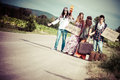 Hippie Group Hitchhiking on a Countryside Road Royalty Free Stock Photo
