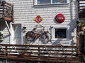 Hippie house with vintage decorations coca cola stop sign rusty bicycle ropes near san francisco Royalty Free Stock Photo