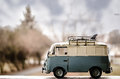 Hippie surfer bus a with surf boards on top Royalty Free Stock Photos