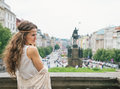 Hippy looking woman tourist standing on wenceslas square prague brunette young in knitted shawl and white blouse tourism travel Royalty Free Stock Photos