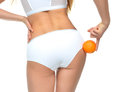 Hips legs buttocks and orange in hand cellulite liposuction woma Royalty Free Stock Photo