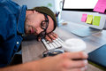 Hipster businessman sleeping at his desk Royalty Free Stock Photo