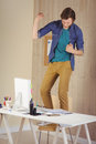 Hipster businessman standing on his chair Royalty Free Stock Photo