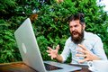 Hipster busy with freelance. Wifi and laptop. Slow internet irritating. Drink coffee and work faster. Deadline is coming Royalty Free Stock Photo