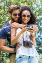 Hipster couple looking at their camera Royalty Free Stock Photo