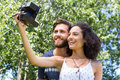 Hipster couple taking a selfie Royalty Free Stock Photo