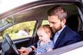 Hipster father with his little daughter in the car Royalty Free Stock Photo