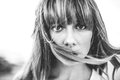 Hipster girl with fringe staring at camera in black and white artistic shot Stock Photo
