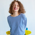 Hipster girl holding a vivid color skateboard Royalty Free Stock Photo