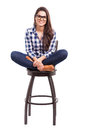 Hipster girl sitting on a chair attractive young hispanic with her feet up and smiling Royalty Free Stock Image
