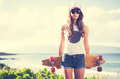 Hipster girl with skate board wearing sunglasses Royalty Free Stock Photo