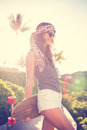 Hipster girl with skate board wearing sunglasses beautiful Stock Image